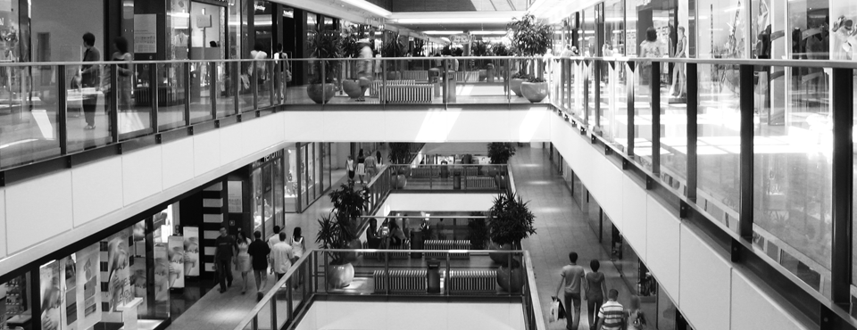 Why do shops cluster? Spatial competition and agglomeration